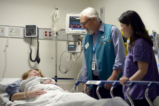 Cardiac patient with nurse and volunteer