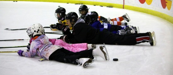 Youth learning some tips and tricks from Olympic Gold Medalist Cheryl Pounder at Scotiabank Skates.
