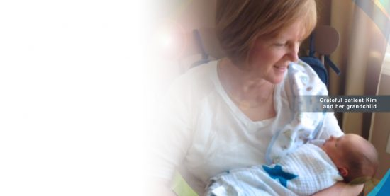 Image of Grateful Patient Kim with her grandchild.