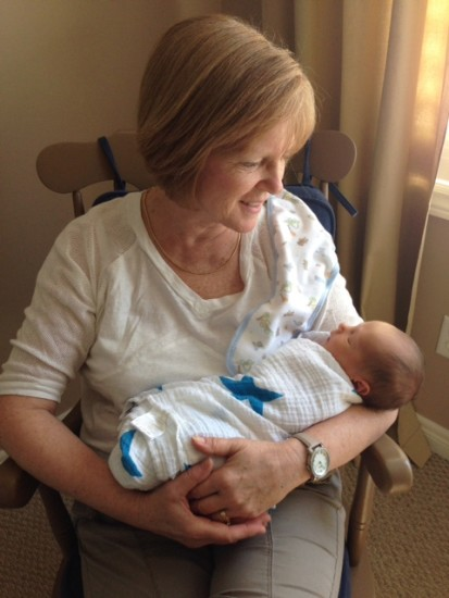 Image of grateful patient Kim with grand child.